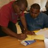 David and John preparing their budget for the event